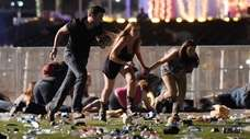 People run from the Route 91 Harvest country