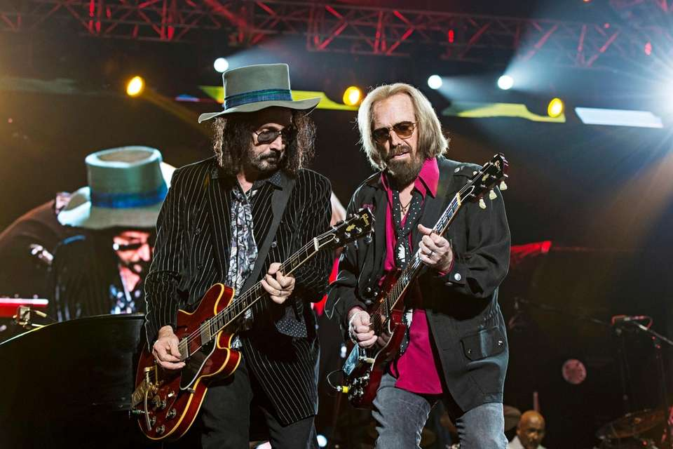 Mike Campbell, left, and Tom Petty perform at