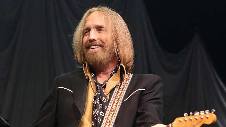 Tom Petty performs in concert with Tom Petty