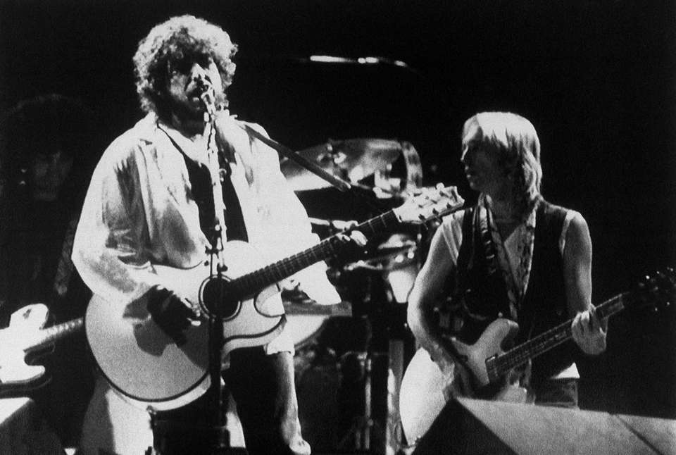 Tom Petty, right, performs with Bob Dylan in