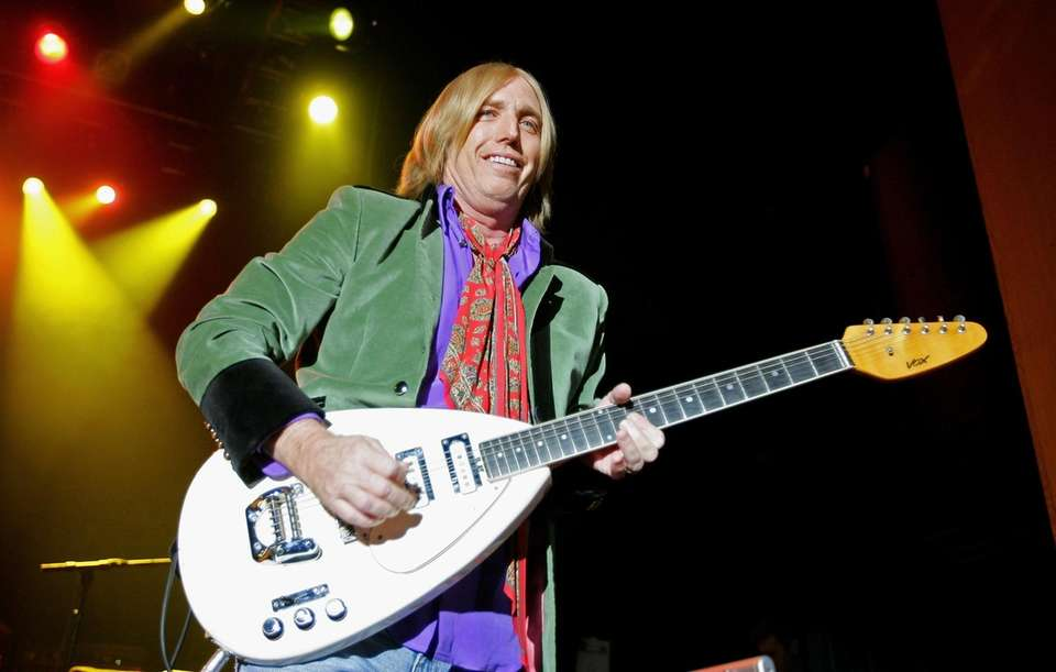 Tom Petty and the Heartbreakers perform during a