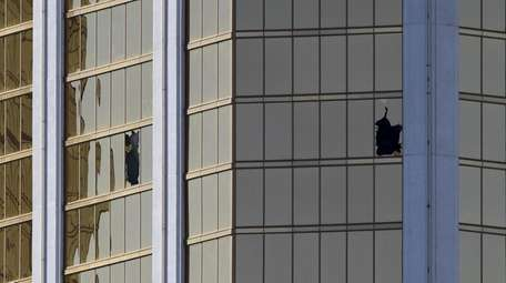Damaged windows of the 32nd-floor room used by