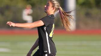 Commack's Katie Kelly plays the ball in the