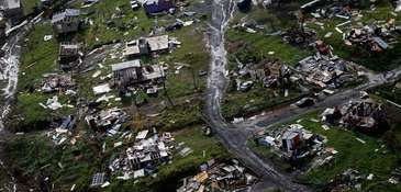 Destroyed communities are seen in the aftermath of