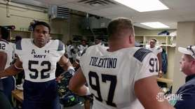 Navy head coach Ken Niumatalolo delivers a motivating