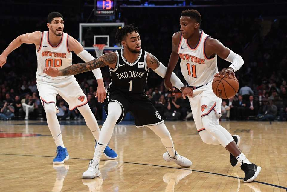 New York Knicks guard Frank Ntilikina is defended