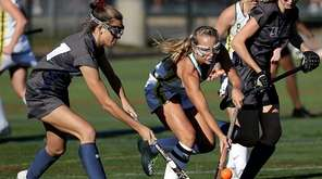 Ward Melville's Kerri Thornton takes the ball from
