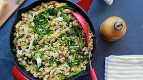 White beans, pasta and broccoli raab simmered in