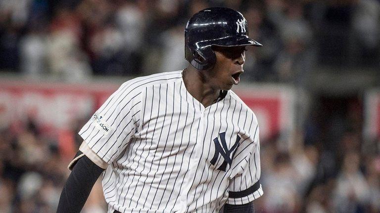 Yankees' Didi Gregorius react while rounding third base
