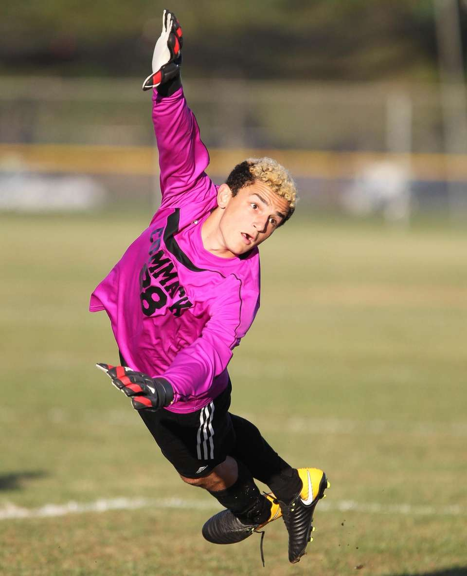 Commack's Goalie Brian Mirman dives for the ball