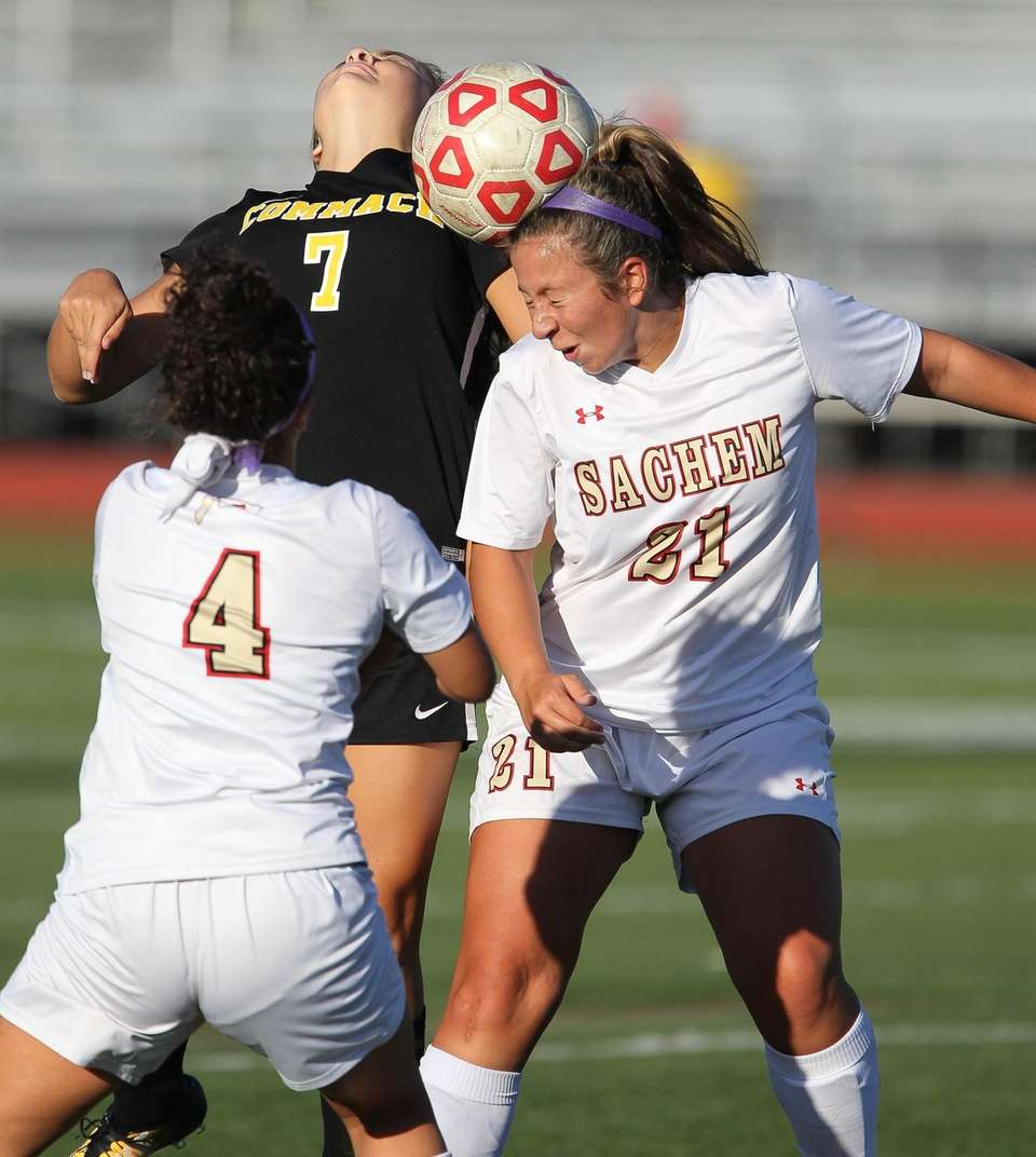 Sachem East's Julianna Kelton plays a header while