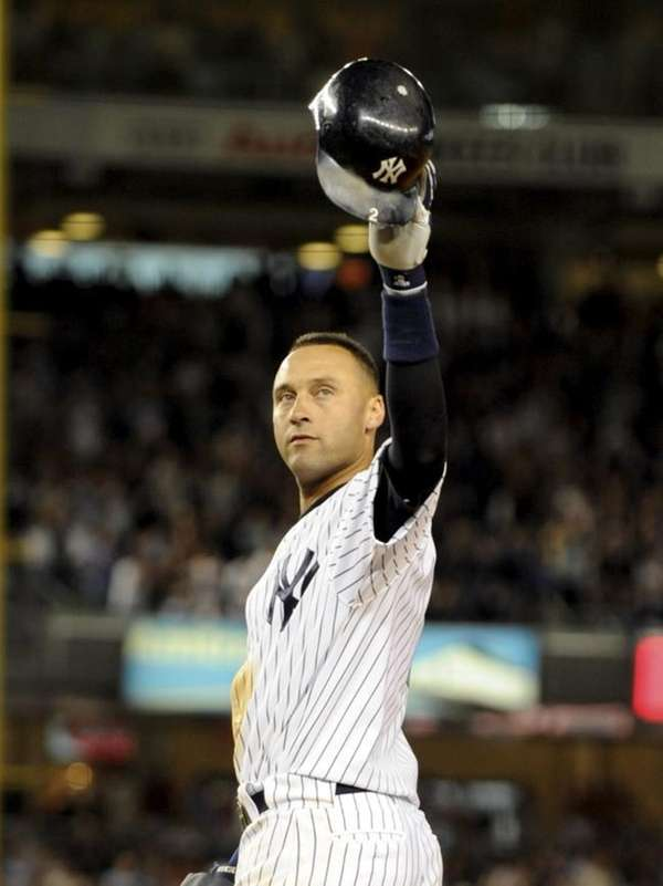 Derek Jeter waves to the crowd after tying