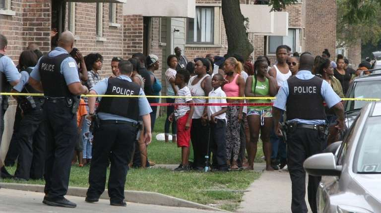 Police investigate the scene of a shooting in