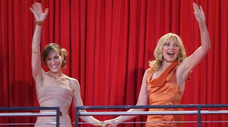Sarah Jessica Parker, left, and Kim Cattrall greet