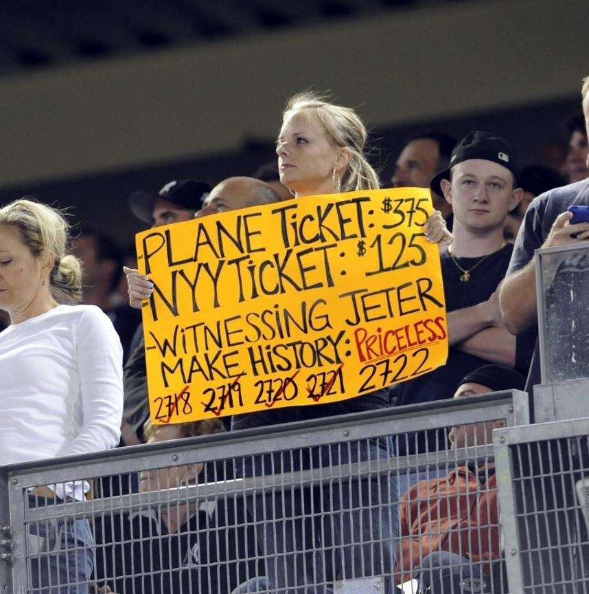 A fan holds a sign celebrating Derek Jeter's