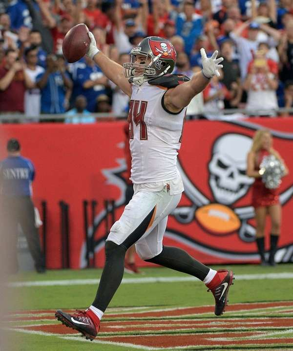 Buccaneers tight end Cameron Brate celebrates his 14-yard