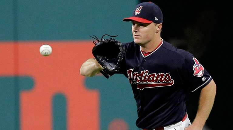 Indians' Jay Bruce fields a single hit by