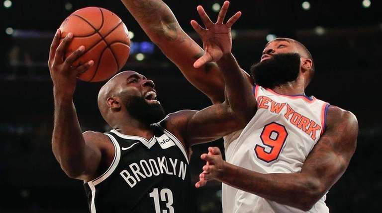 Nets forward Quincy Acy goes up for a