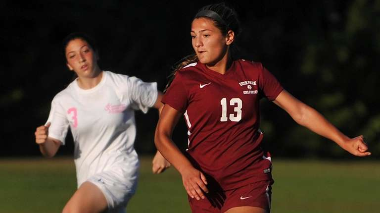 Katie Buquicchio of Deer Park moves a ball