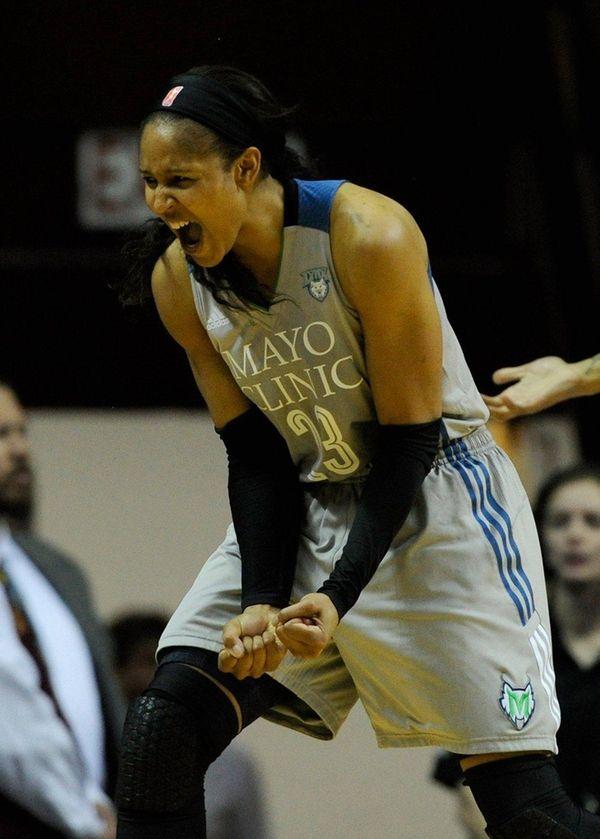 Maya Moore of the Lynx celebrates a call