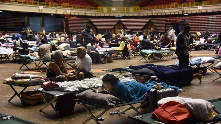Refugees are seen at the Roberto Clemente Coliseum