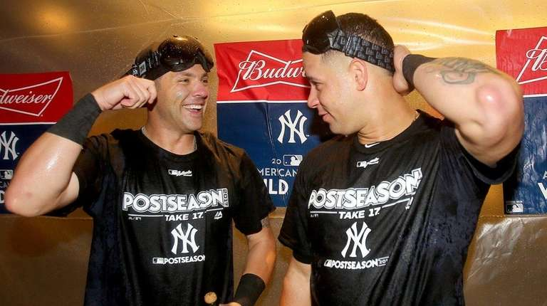 Austin Romine and Gary Sanchez celebrate the win