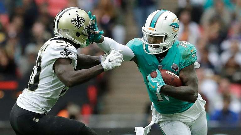 Miami Dolphins wide receiver Jarvis Landry, right, stiff