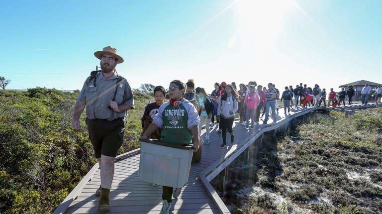 Ranger Kelsey Sucena leads a group of students