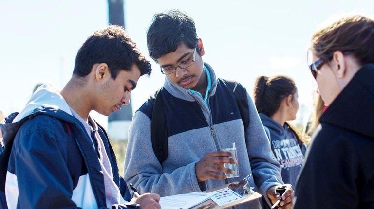 Students Vineet Molhotra, 17, and Hasnain Sayed, 15,