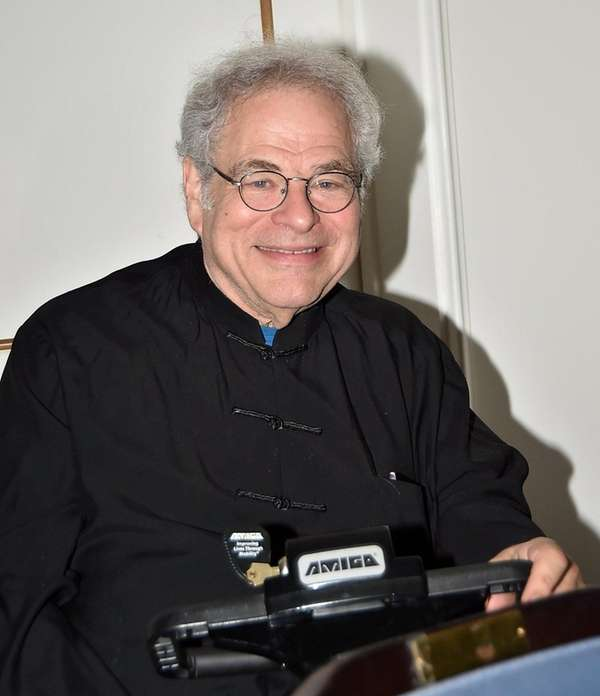 Violinist Itzhak Perlman attends the screening of the