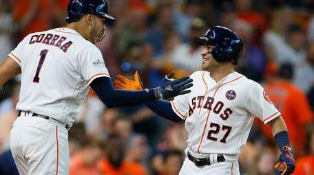 Jose Altuve #27 of the Houston Astros celebrates