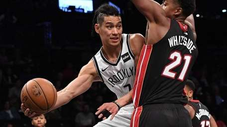 Brooklyn Nets guard Jeremy Lin passes the ball