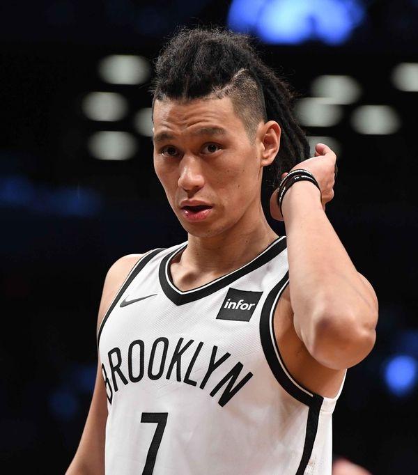 Brooklyn Nets guard Jeremy Lin looks on against