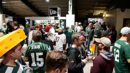 Fans fill the concourse at Lambeau Field during