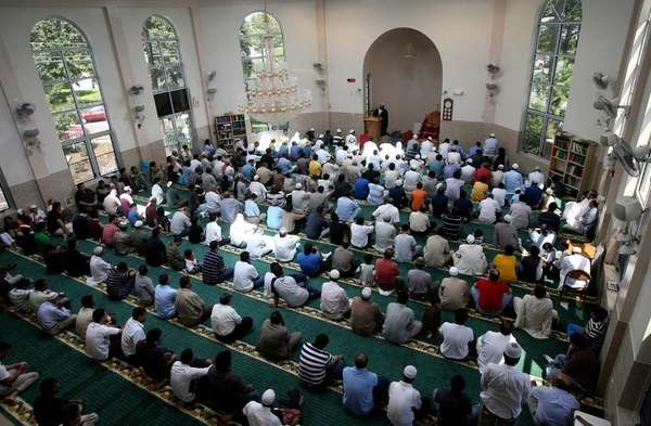 People pray at the Masqid Darul Quran mosque