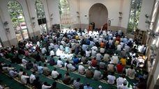 People pray at the Masqid Darul Quran mosque