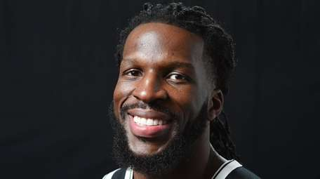 DeMarre Carroll of the Brooklyn Nets poses for