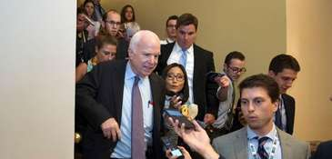 Sen. John McCain (R-Ariz.) is followed by reporters