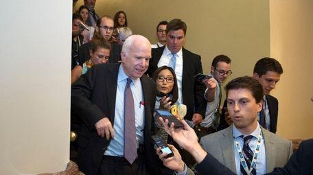 Sen. John McCain (R-Ariz.) is followed by reporters