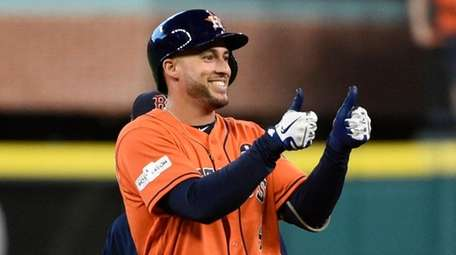 Houston Astros' George Springer celebrates after hitting a