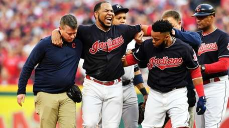 Edwin Encarnacion of the Cleveland Indians receives medical