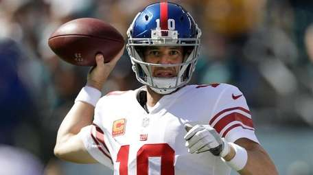 New York Giants' Eli Manning passes during the