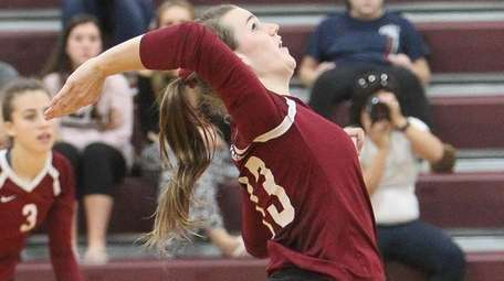 Kings Park's Erika Benson plays the ball in