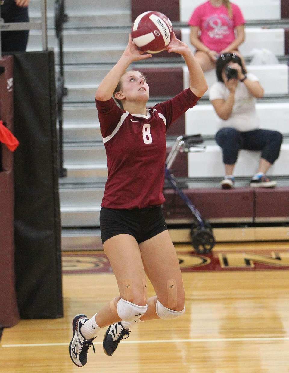 Kings Park's Haley Holmes (8) sets the ball