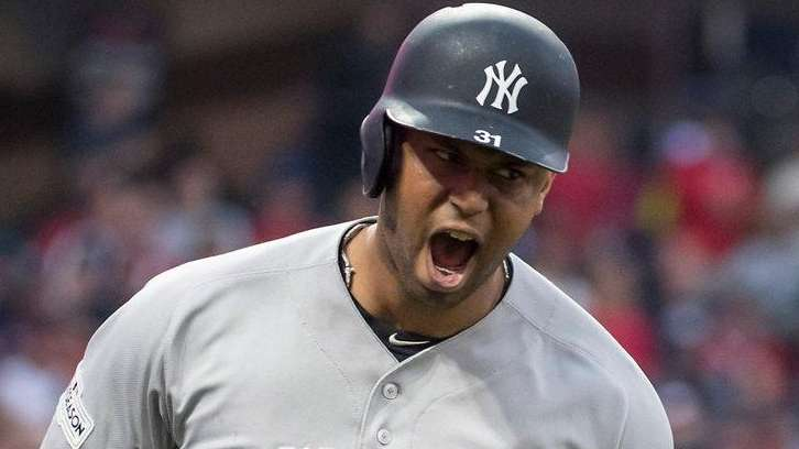 Aaron Hicks is pumped after his three-run