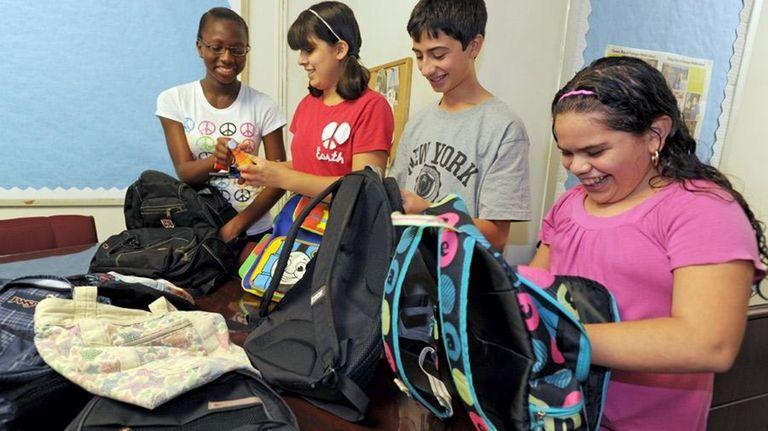 Eighth-graders Janiece Morgan, left, Marissa Ramirez, Joseph Amorosino,
