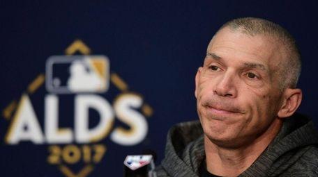 New York Yankees manager Joe Girardi listens to