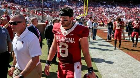 Oklahoma quarterback Baker Mayfield walks off the field