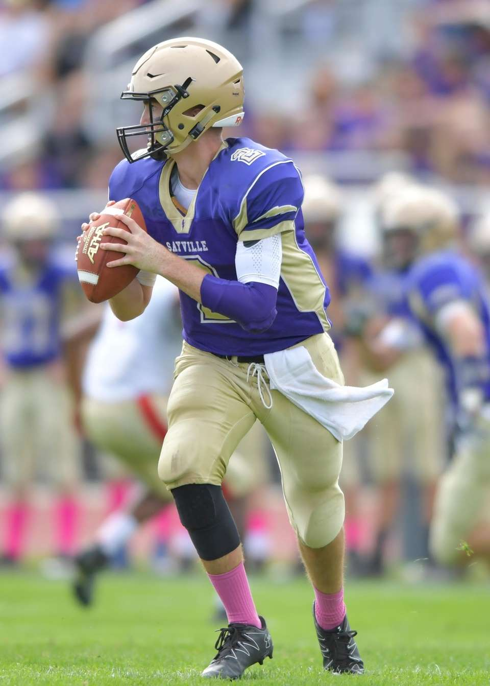 Sayville's Jacob Cheshire rolls out to the left