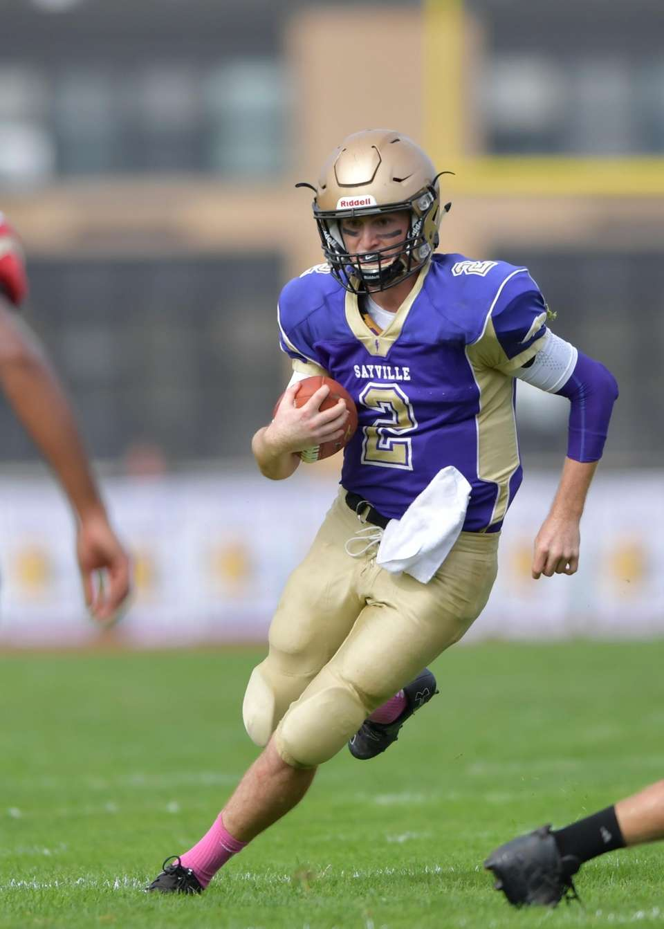 Sayville's Jacob Cheshire carriers the ball during the